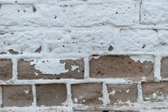 White brown brick wall, paint, cracks, background, old, texture. White brown brick wall, paint cracks background. old texture graphics roughness shabby, vintage Stock Image