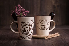 White, Brown Ceramic Coffee Mugs on Wooden Background Royalty Free Stock Images