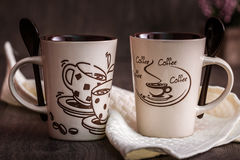 White, Brown Ceramic Coffee Mugs on Wooden Background Stock Photos