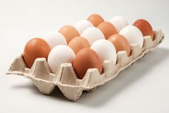 White and brown chicken eggs. Royalty Free Stock Photography