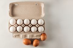 White and brown chicken eggs. Royalty Free Stock Image