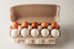 White and brown chicken eggs. Royalty Free Stock Photo