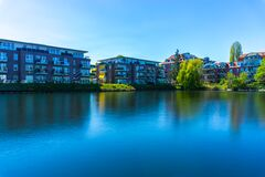 White and Brown Concrete Building Beside Body of Water Under Blue Sky during Datytime Royalty Free Stock Photos