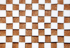 White and brown cubes of sugar Stock Photos
