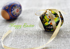 White and brown easter eggs with golden bow Royalty Free Stock Photo
