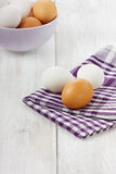 White and brown eggs. On a linen napkin Stock Images