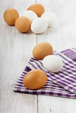 White and brown eggs. On a linen napkin Stock Photo