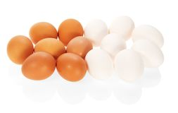 The white and brown eggs Stock Images