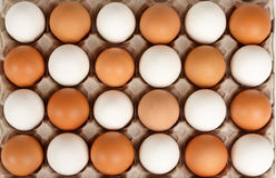 White and brown eggs in staggered order Stock Images