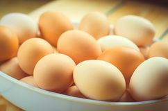 White and brown fresh chicken eggs in a plate. concept of easter. Cooking ingredients Stock Photo