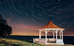 White and Brown Gazebo I Seashore Time Lapse Photography Stock Photography