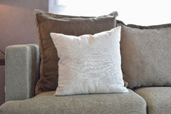 White, brown and grey velvet pillows setting up on sofa Stock Images