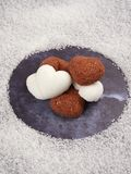 White and brown heart shaped sugar cubes stock photos