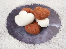 White and brown heart shaped sugar cubes royalty free stock images