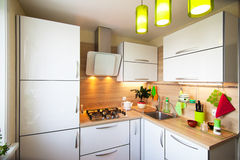 White and brown interior for small kitchen royalty free stock images