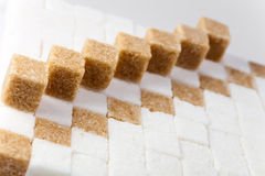 White and brown lumpy sugar Royalty Free Stock Photo