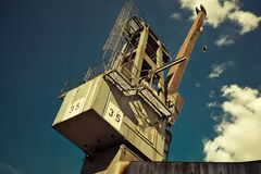White and Brown Metal Crane Royalty Free Stock Image