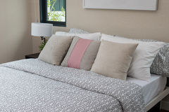 White and brown pillows on bed. Modern bedroom interior with white and brown pillows on bed Royalty Free Stock Images