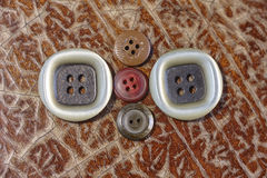 White brown and red buttons Stock Photography