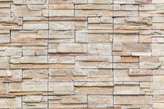 The white brown stone on concrete wall, textured wall background stock photography