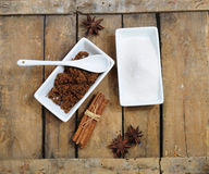 White and brown sugar. Sweet ingredients - white and brown sugar, chocolate, cinnamon and anise stock photos