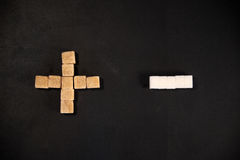 White and brown sugar cubes Stock Photos