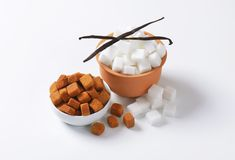 White and brown sugar cubes Stock Image