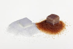 White and brown sugar. Cubes and refined Royalty Free Stock Photography