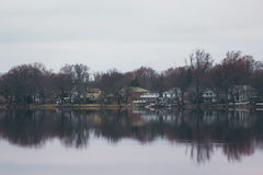 White and Brown Village Near the Body of Water Royalty Free Stock Image