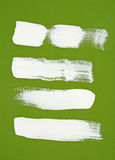 White brush strokes on green background Royalty Free Stock Photo