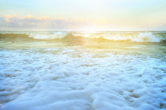 White bubbles on the beach by waves Royalty Free Stock Images