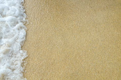 White bubbles created on the beach. By ocean waves on seashore Stock Photography