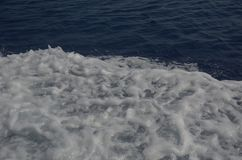 White bubbling wave on the blue water of the Mediterranean Sea stock photos