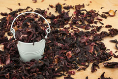 White bucket with  dried hibiscus  on the wooden floor Royalty Free Stock Image