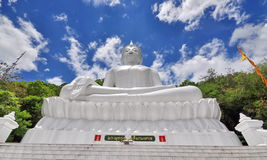 White buddha and blue sky Royalty Free Stock Images