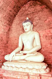 White Buddha burmese style in front of brick stone wall Royalty Free Stock Images