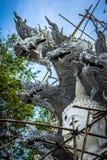 White Buddha With Dragon Concrete Statue E stock photo
