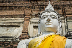 White buddha image. In Wat Yai Chai Mongkol you'll find a large white statue of the Buddha, around the large Chedi that was erected in 1592 to celebrate King Stock Photos