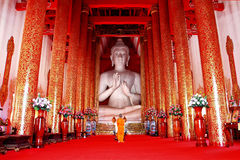 White buddha and monk Stock Photos