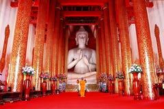 White buddha and monk stock photos