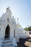 White buddha pagoda temple in Wat Pra Tard Doi Kong Mu temple wi Royalty Free Stock Images