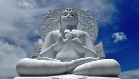 White  Buddha sculpture under blue sky and white cloud Royalty Free Stock Photography