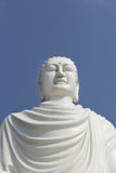 White Buddha statue on the background of bright blue sky Stock Photo