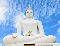 White buddha statue on blue sky Royalty Free Stock Photography
