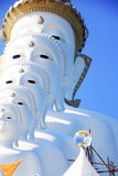 The white Buddha statue. On blue sky in temple at Pechaboon Province,Thailand Stock Photo