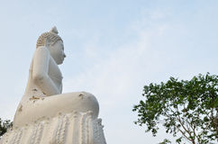 White Buddha statue and blue sky in Thailand Royalty Free Stock Photo