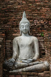 White Buddha statue. With bricks backgrounds Royalty Free Stock Photography