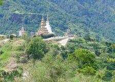 5 white buddha statue and buddhist pagoda on the hill Stock Image