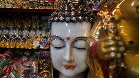 White buddha statue head shot with more idols in background royalty free stock photos
