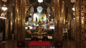 White Buddha statue in Inthakhin Sadue Muang Temple stock video
